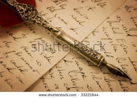 Antique pen lying on a piece of a burnt-out paper by Stukkey, via ShutterStock