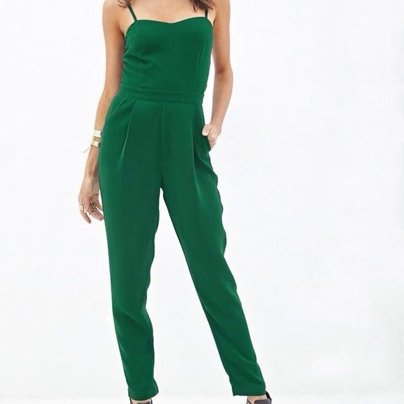 Hunter Green Jumpsuit with pockets Green jumpsuit with side pockets. Worn once for an event. One of my absolute favorites! Its also figure flattering! Excellent condition. Size small but could fit an XS also. NEXT DAY SHIPPING!! Forever 21 Pants Jumpsuits & Rompers