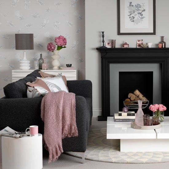 Decorating with darker colours is definitely having a moment but in the wrong room it can make you feel like you're living in a cave. Why not try darker accents like in this room. The sofa and the fire surround add drama but the blush tones add a softer touch.