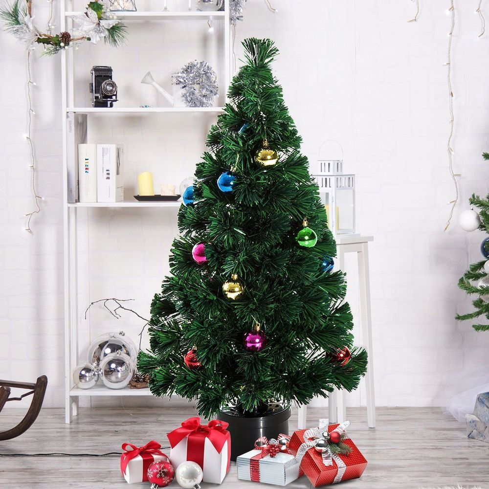 Artificial Christmas Solid Green Color Pine Tree With Rotating Stand ...