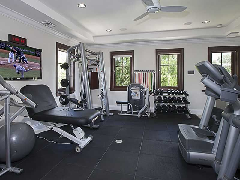 Installing a giant tv in your home gym is a great distraction from