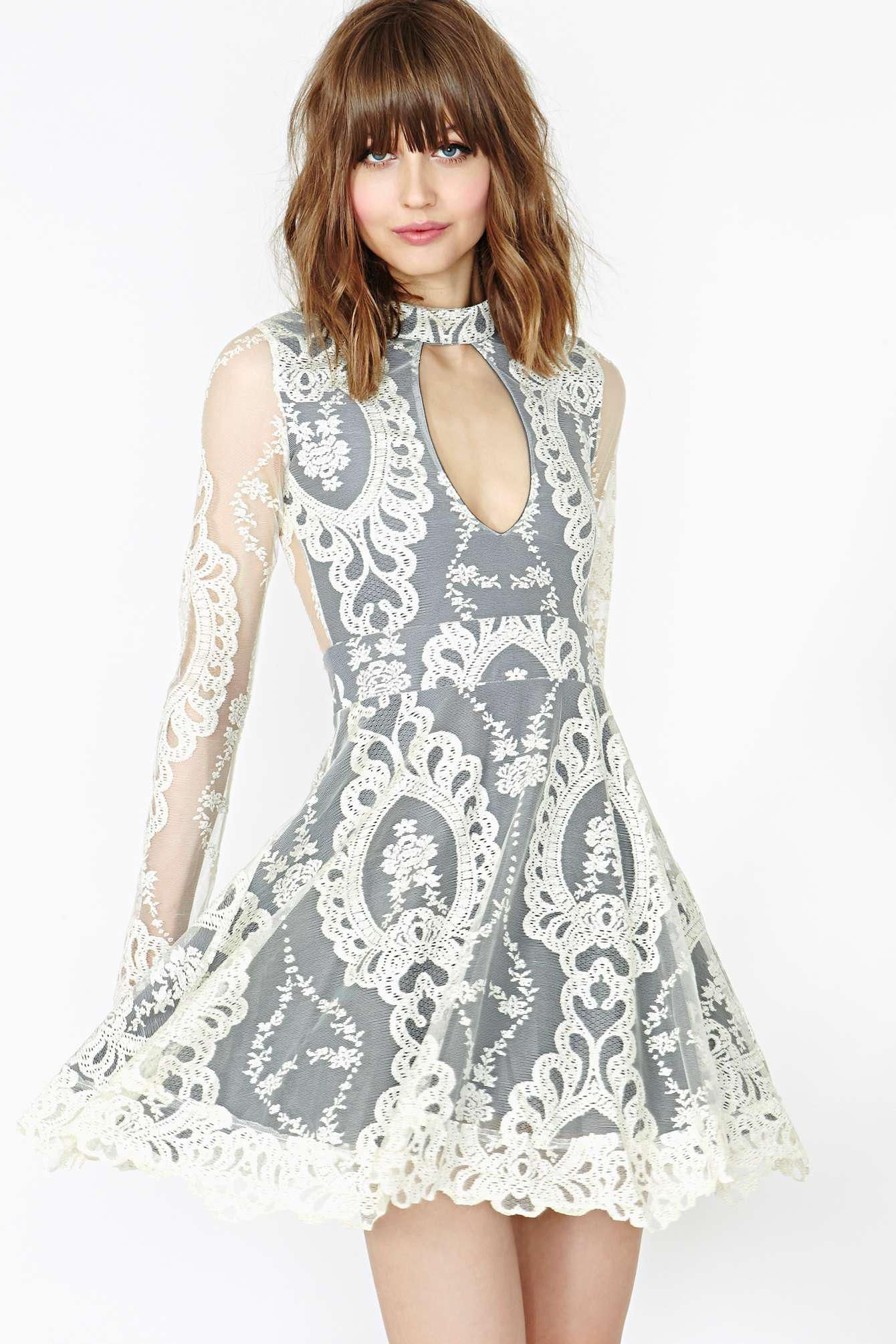 Super cute ivory lace dress featuring a gray underlay and high