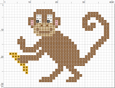 Cartoon monkey cross stitch pattern (with banana).  For personal use only.  (c) Erin E. Turowski, 2012.