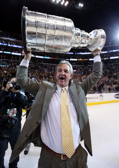 Head Coach Darryl Sutter holds up the Stanley Cup