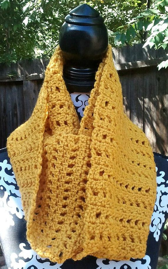 This hand crocheted infinity scarf is made of soft warm threads. This piece is good for all occasions. This scarf measures 5ft in length and can