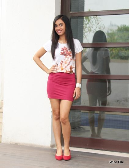 Cute pink mini skirt with a white printed top... Its awesome ...