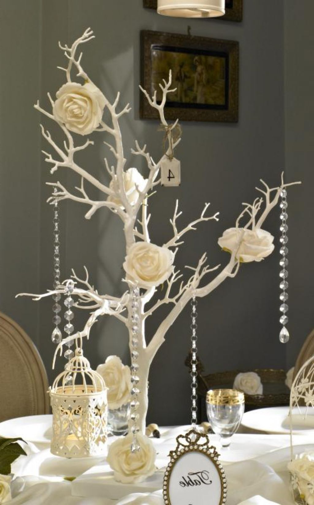Beautiful White Tree Wedding Table Decor That Is Decorated With Flowers Small Bird Cage