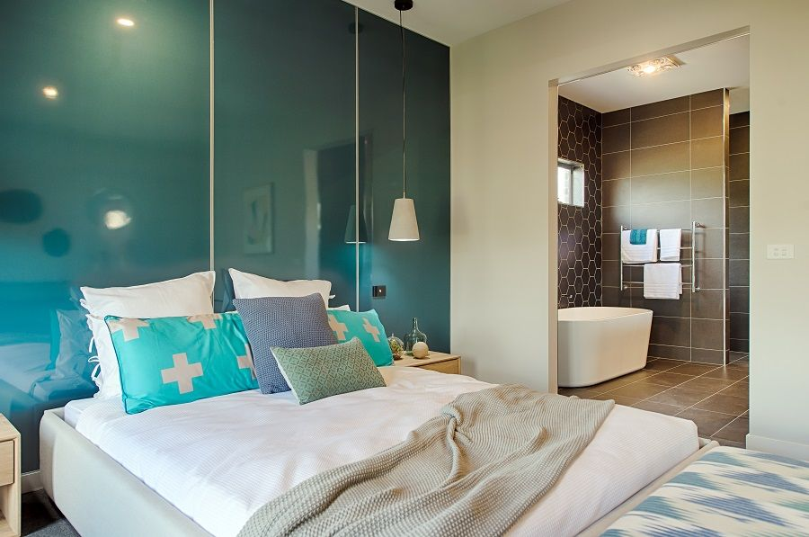this aqua blue featurewall creates a cool and relaxing