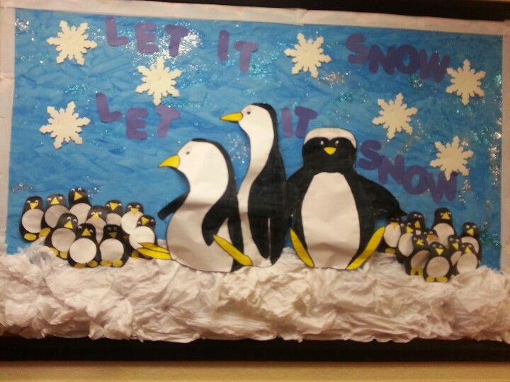 "My Winter wonderland bulletin board. I used tissue paper for the ""snow"" and the kids created the smaller penguins. #winterbulletinboard  #bulletinboard"