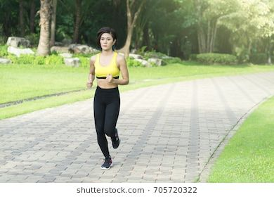25d7e8ed16c12 Sport girl asian woman is running in the park.Sport fitness model training  outdoor for marathon.