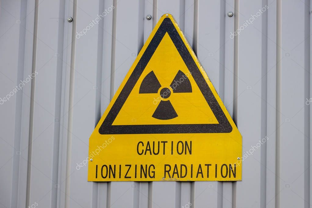 Caution ionizing radiation sign on the wall  Stock Photo
