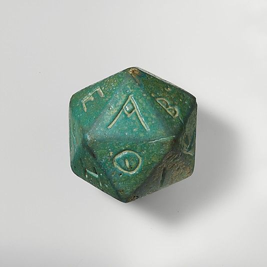 Die (MMA 37.11.3) - d20 Faience polyhedron inscribed with letters of the Greek alphabet. Mid-Imperial Roman (2nd-3rd century CE). Dimensions: H.: 2 7/16 in. (6.2 cm). In the collection of the Metropolitan Museum of Art, Gallery 171.