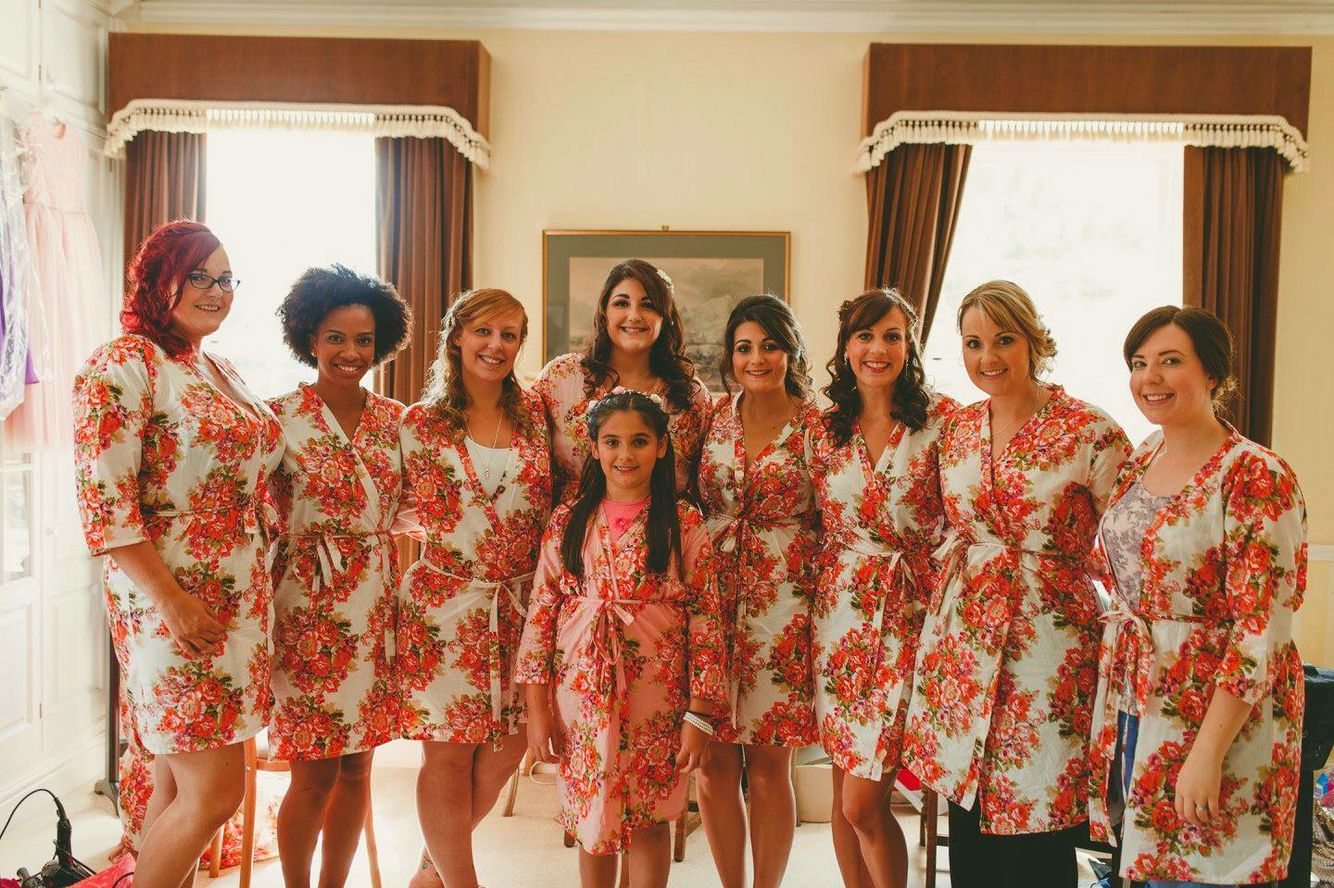 Beautiful bridesmaid in matching floral robes
