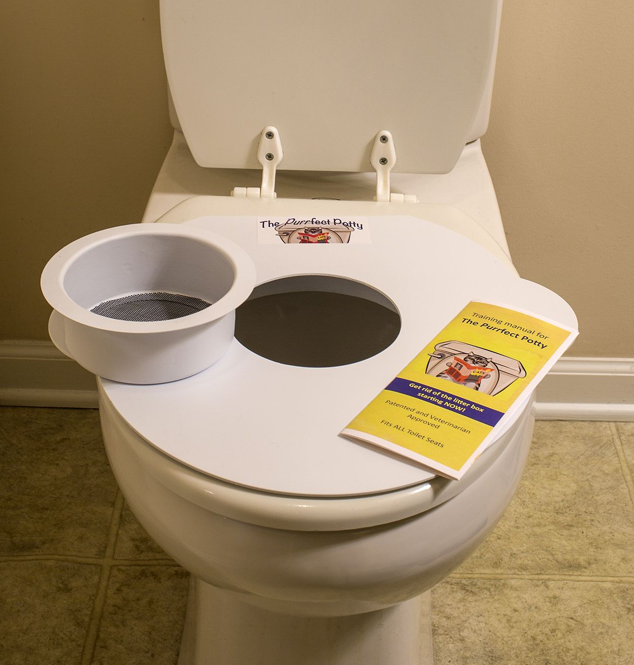 A Cat Toilet Training Seat That Trains Your Cat To Use The Toilet