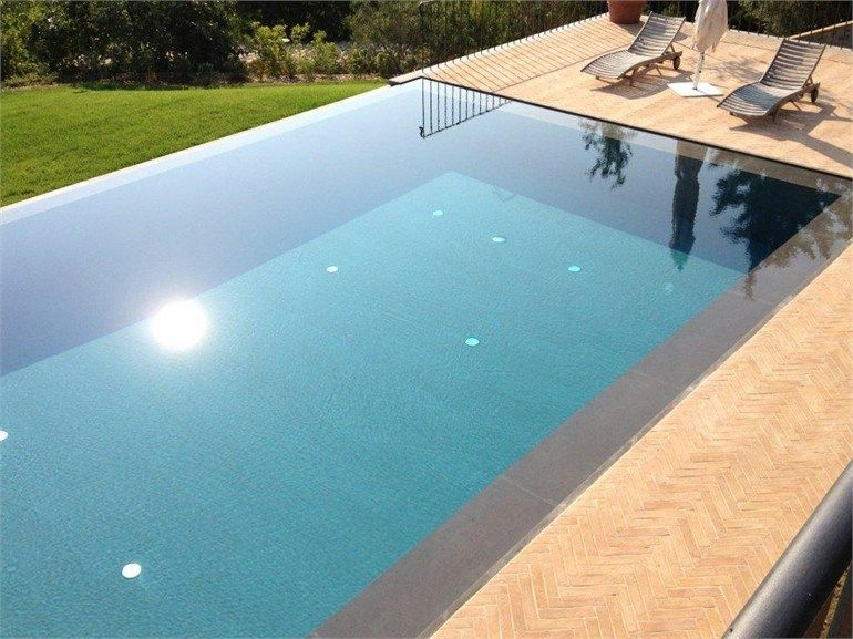 Infinity Swimming Pool With Waterfall By Indalo Piscine Pool
