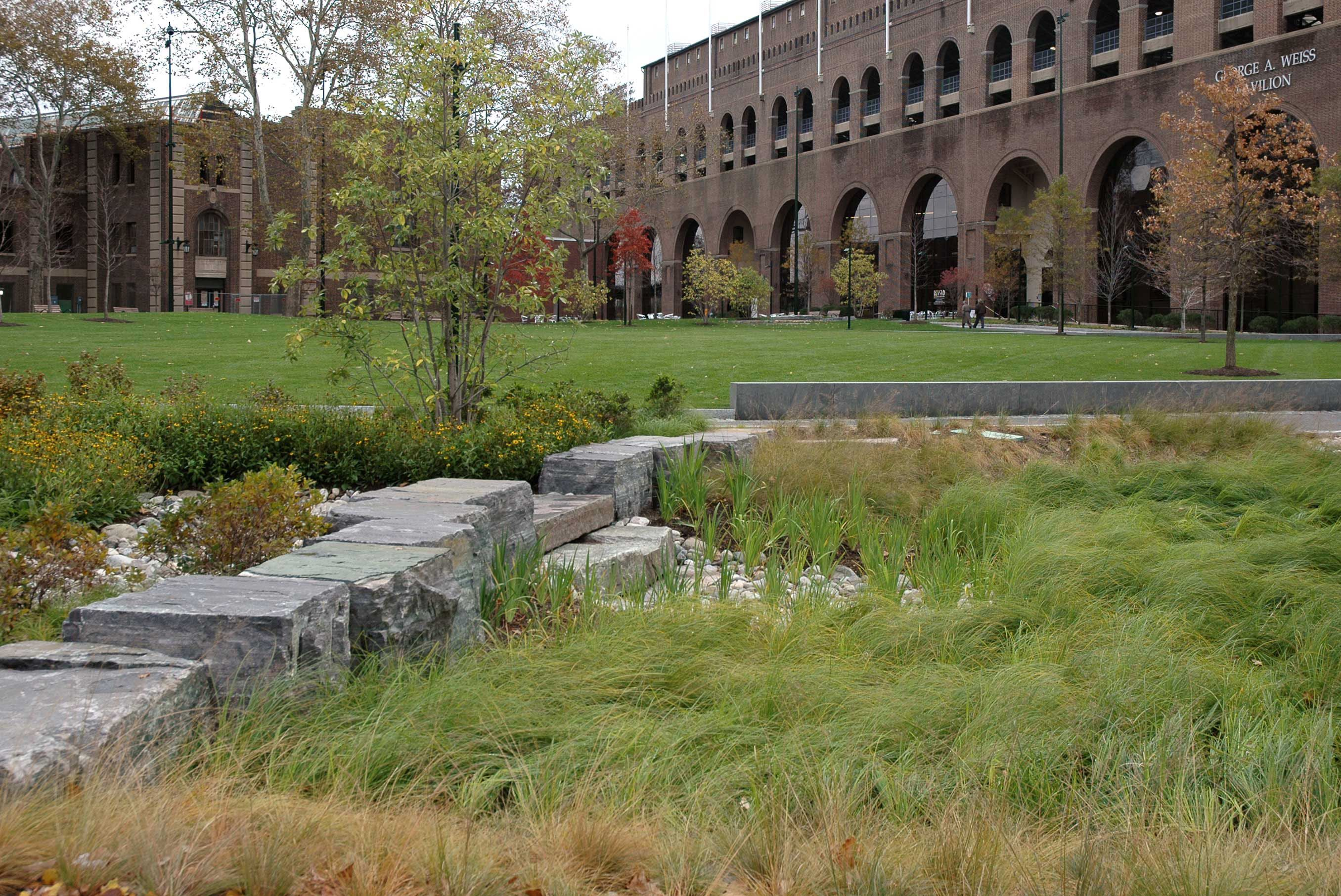 Corinthian Granite And American Granite Boulders And Slab Material Integrate Seamlessly Into The Rain Garden Landscape Stone Rain Garden Landscape