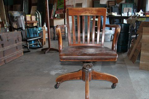 Vintage Wooden Swivel Chair. Price: $90.