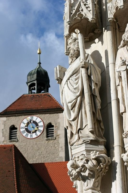 on Sacred Destinations Regensburg Cathedral West Facade Apostle Detail of west portal statues, with clock tower in the background.