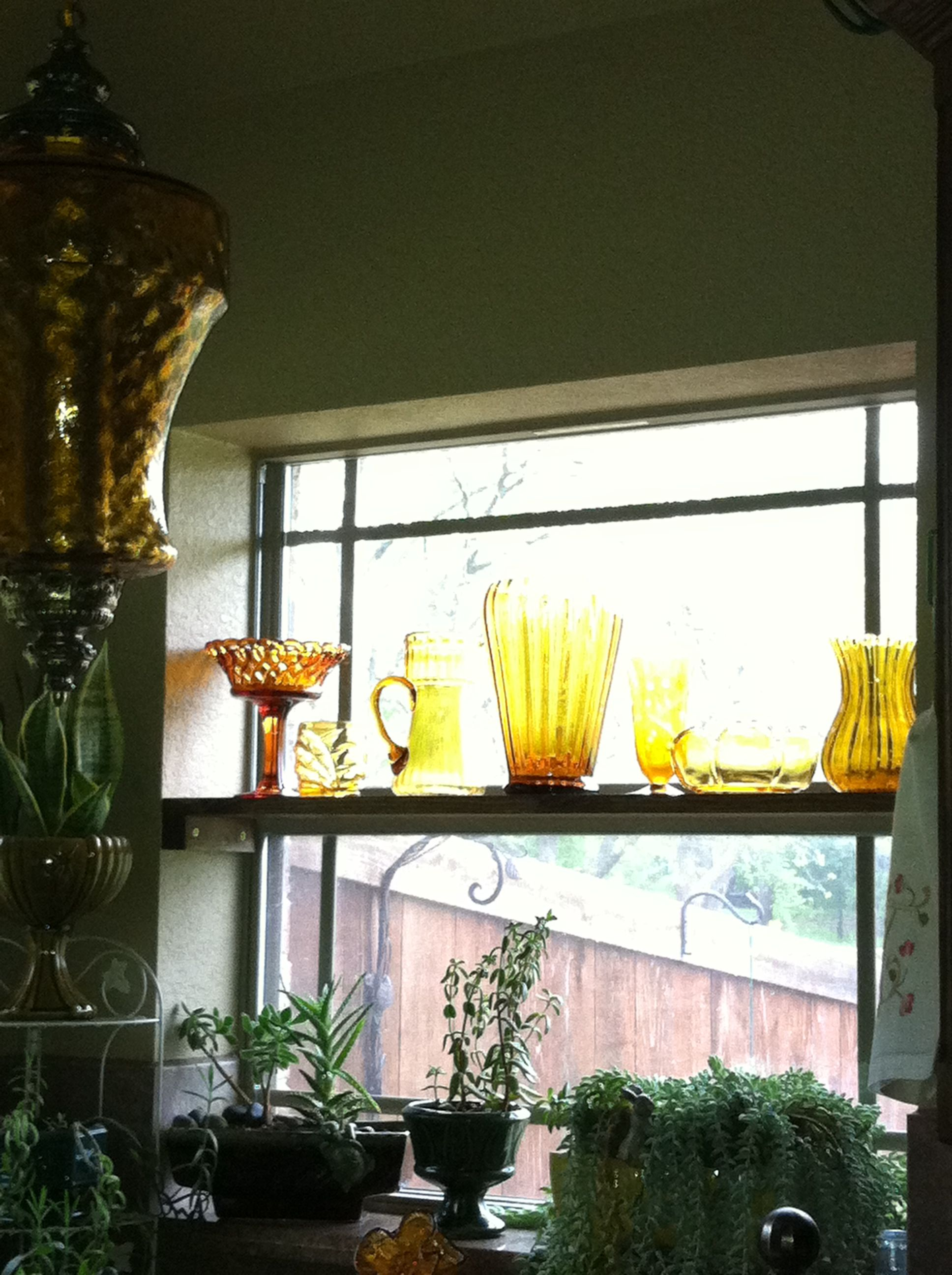 Love the way the light is shining through my Vintage Amber Glass.  The shelf of glass was inspired by my Amber Swag Lamp!