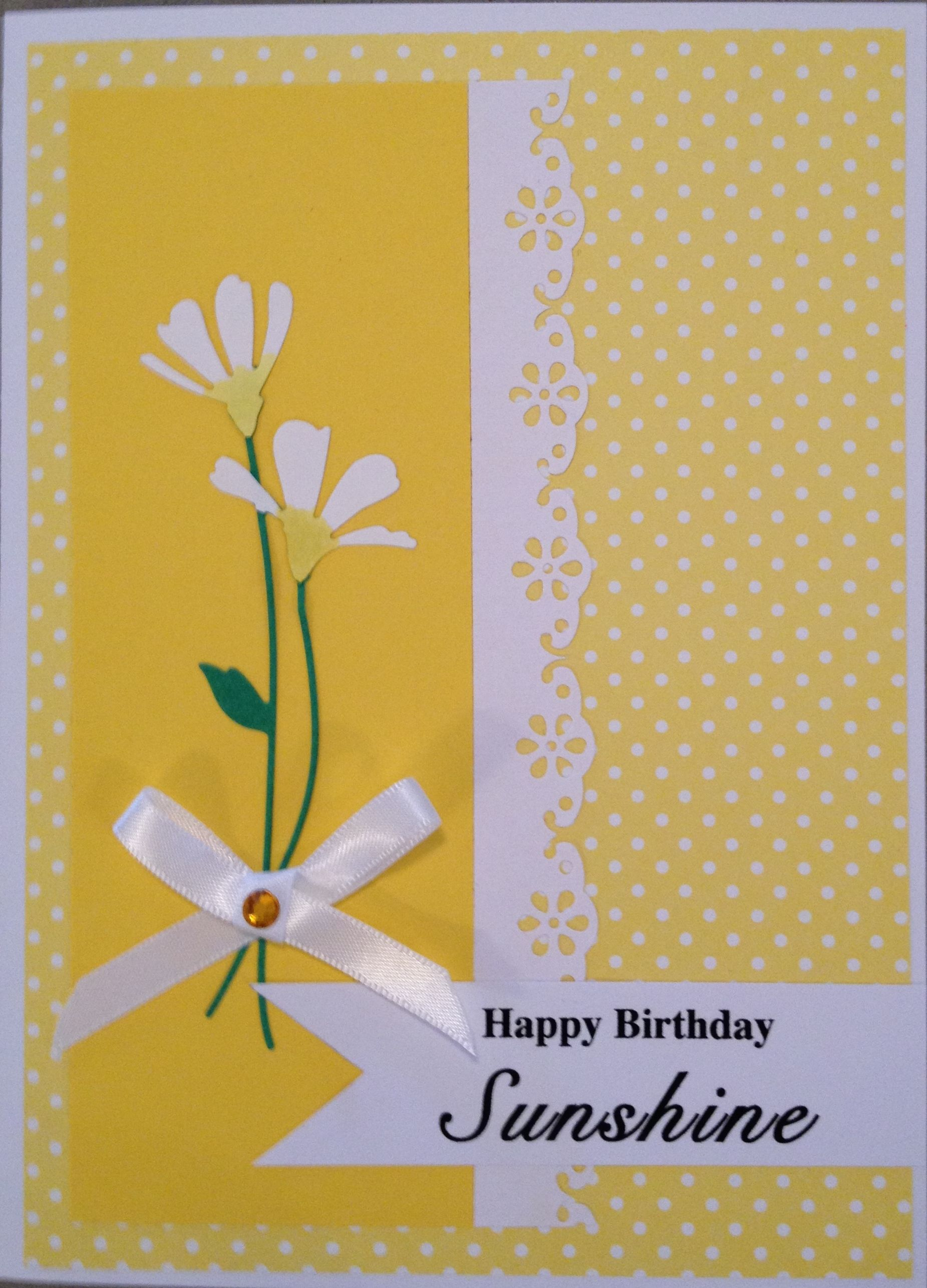 Bright yellow polka dot paper and solid yellow paper used simon