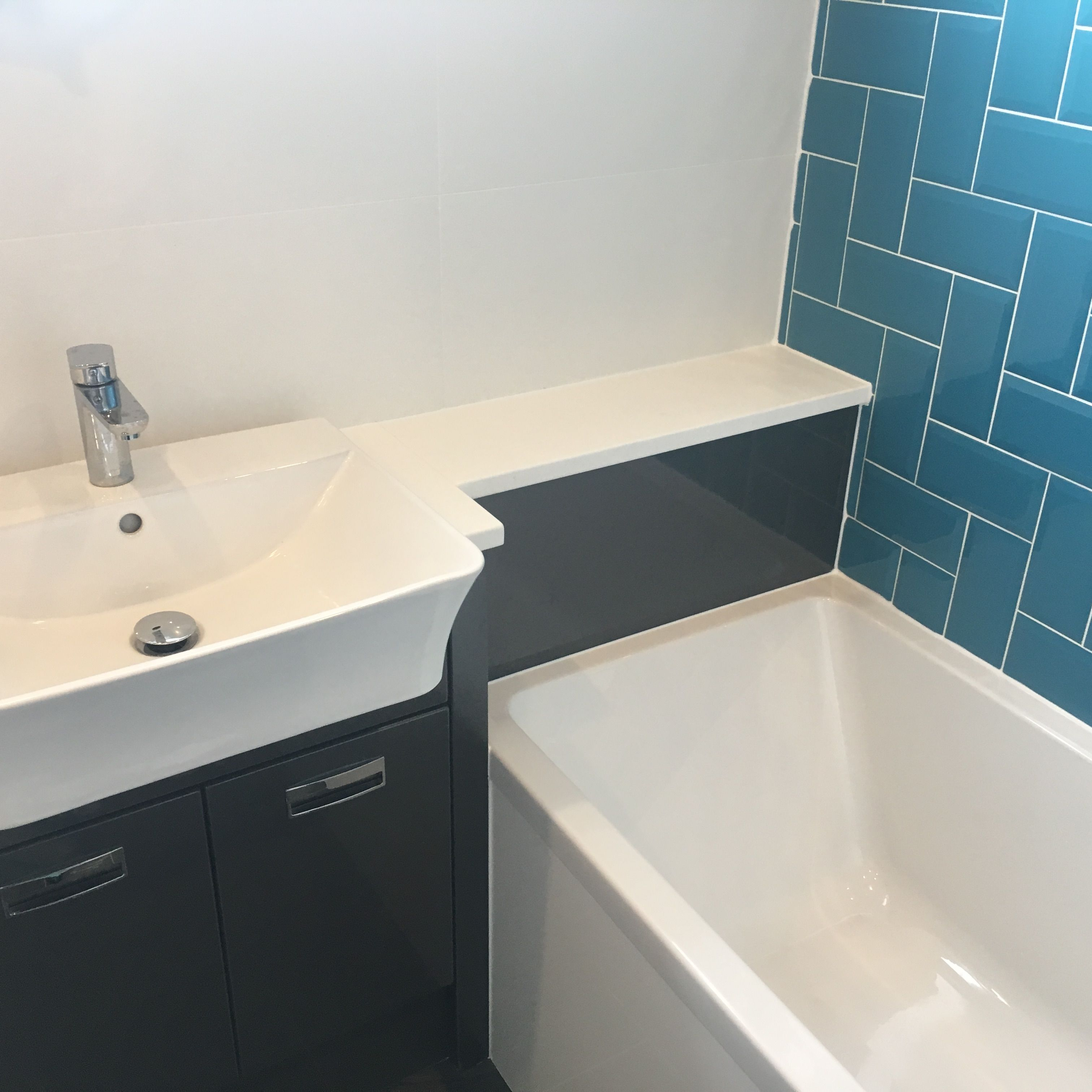 Teal Brick Tiles In Herringbone Pattern With Grey Gloss Basin Vanity Units Teal Bathroom Basin Vanity Unit Bathroom Design