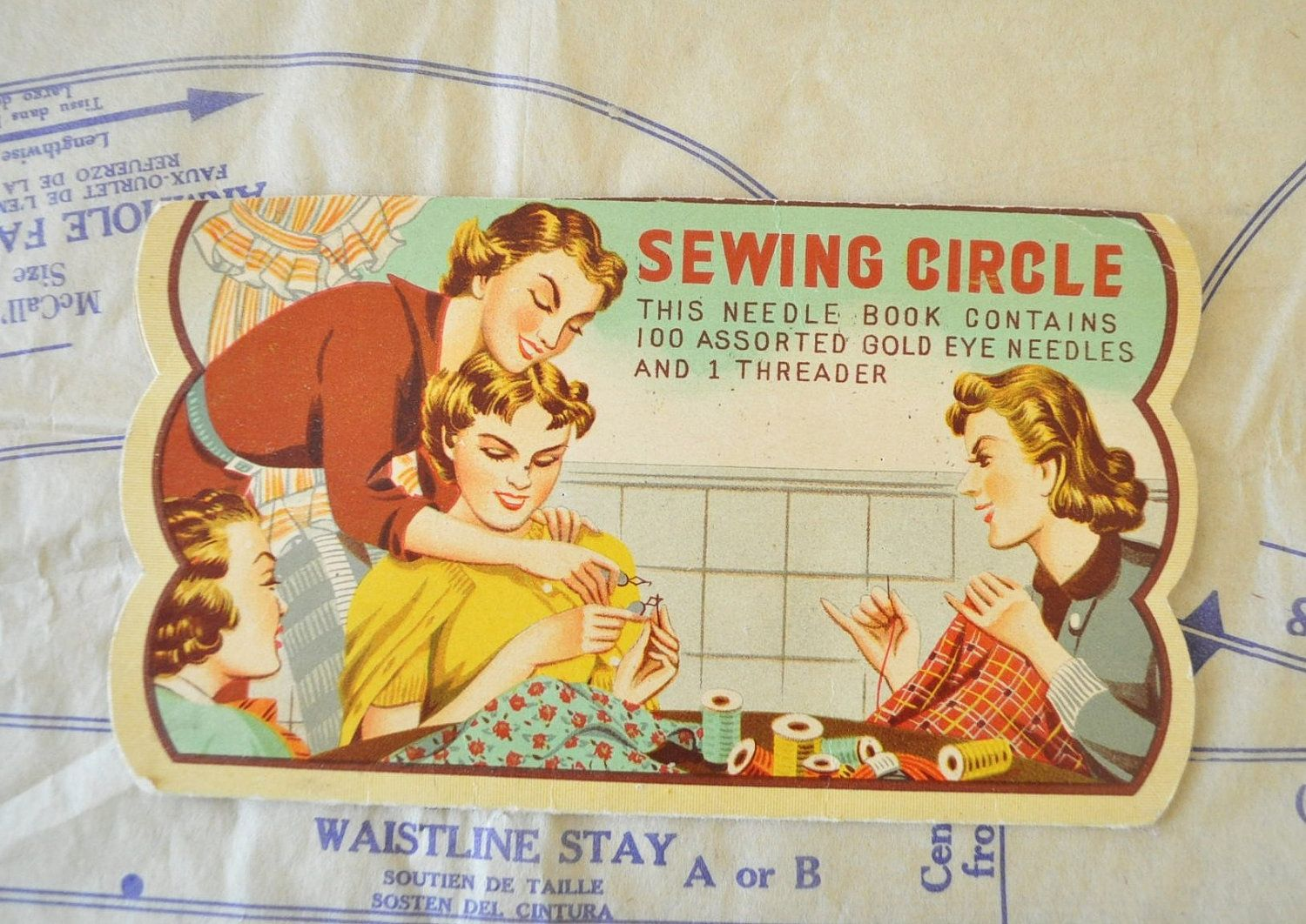 vintage illustrated sewing circle needle book