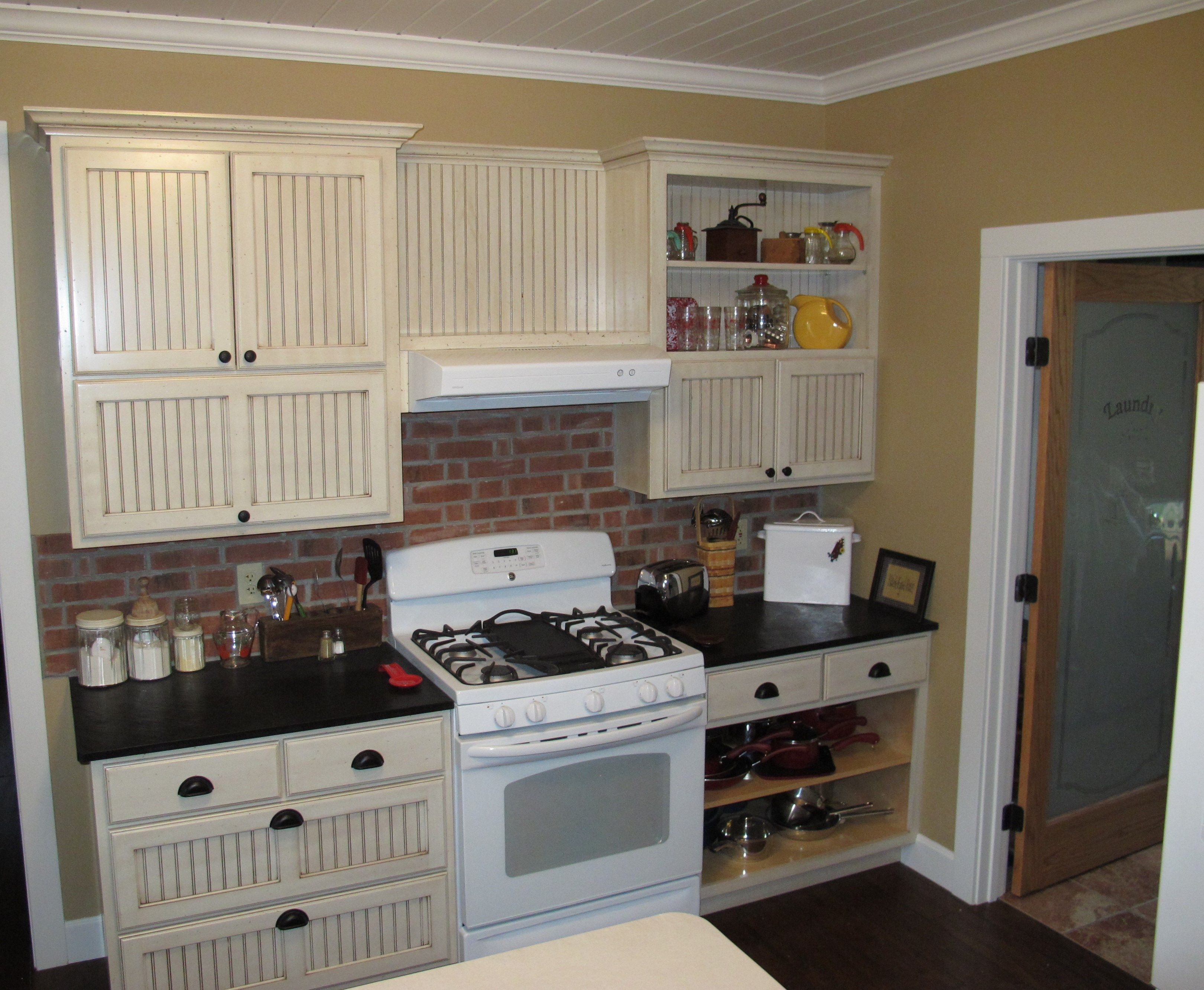 Stove Wall Includes Open Shelving In Upper And Lower Cabinets One Lift Door Open Space Above Vent Hood A Rustic Country Kitchens Low Cabinet Country Kitchen