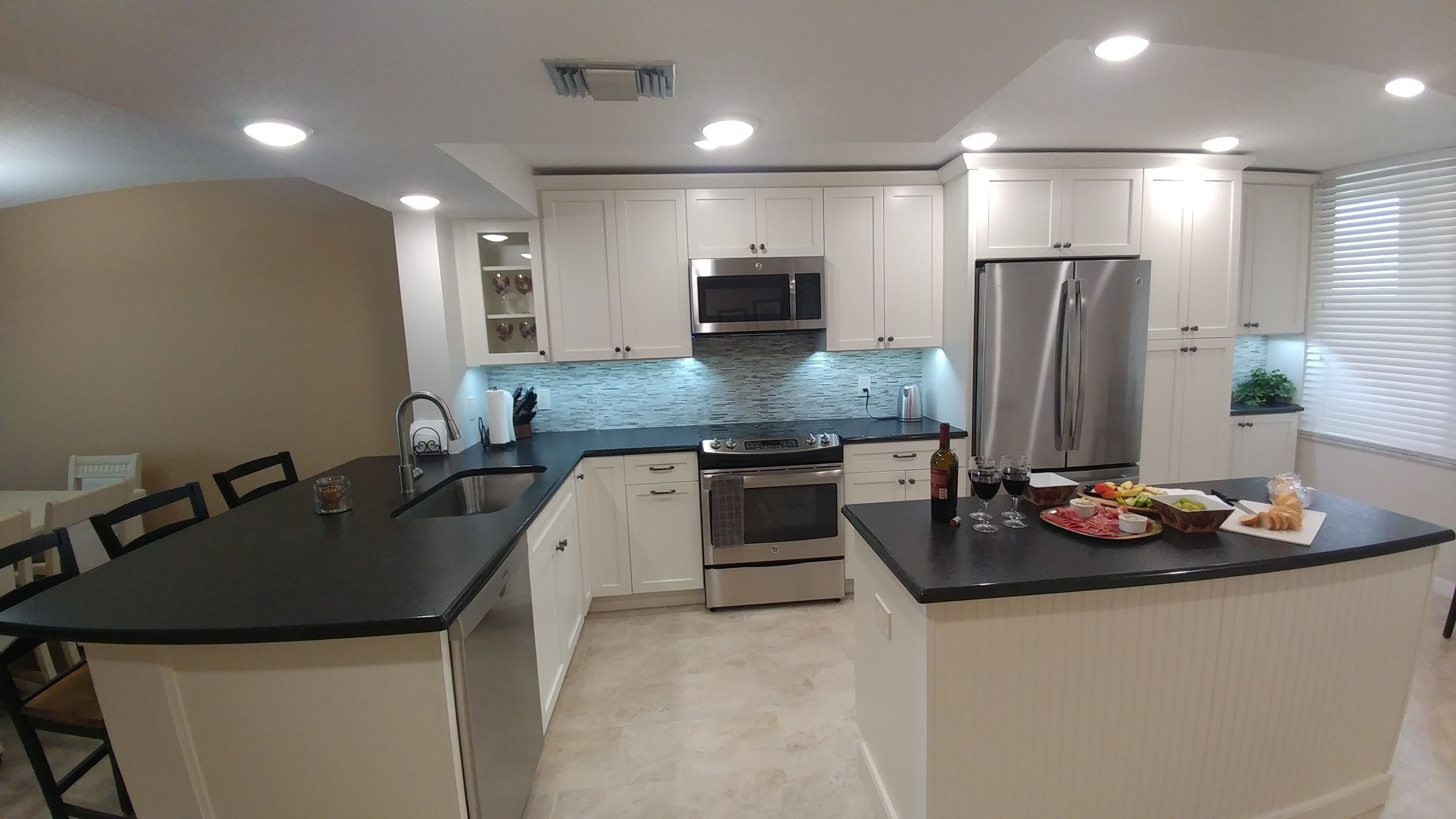 The Kitchen Feels So Much Larger With All Those Walls Removed And Now Our Clients Can See The Gorgeous Gulf Of Mexico Shaker Style Cabinets Leather Granite Shaker Style