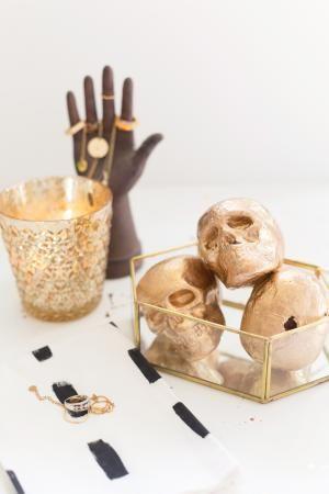 20 Spooky Skull DIYs Perfect For Halloween: DIY Decorative Gold Skulls