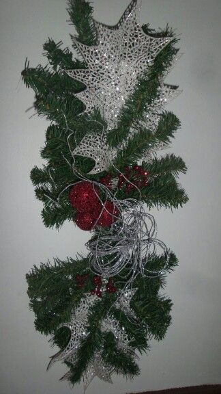 DIY wreath made out of fake Christmas tree branches. Bent ...