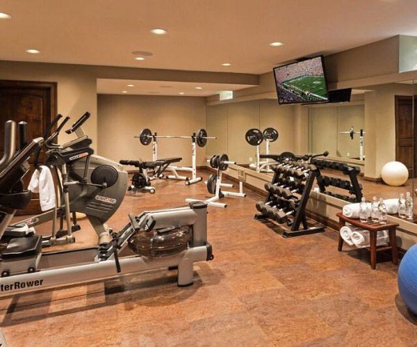 This Upscale Basement Gym Has A Water Rower How Fun Garage - Basement gym ideas