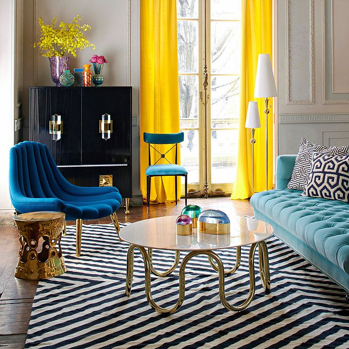 How to Rock Modern American Glamour Interior design, geometric rugs, Jonathan Adler, colourful living room, luxury homes, brass coffee table, lucite, geometric rugs, Slim Aarons wall prints, Hollywood decor, Palm beach chic Well if you love colour, there'