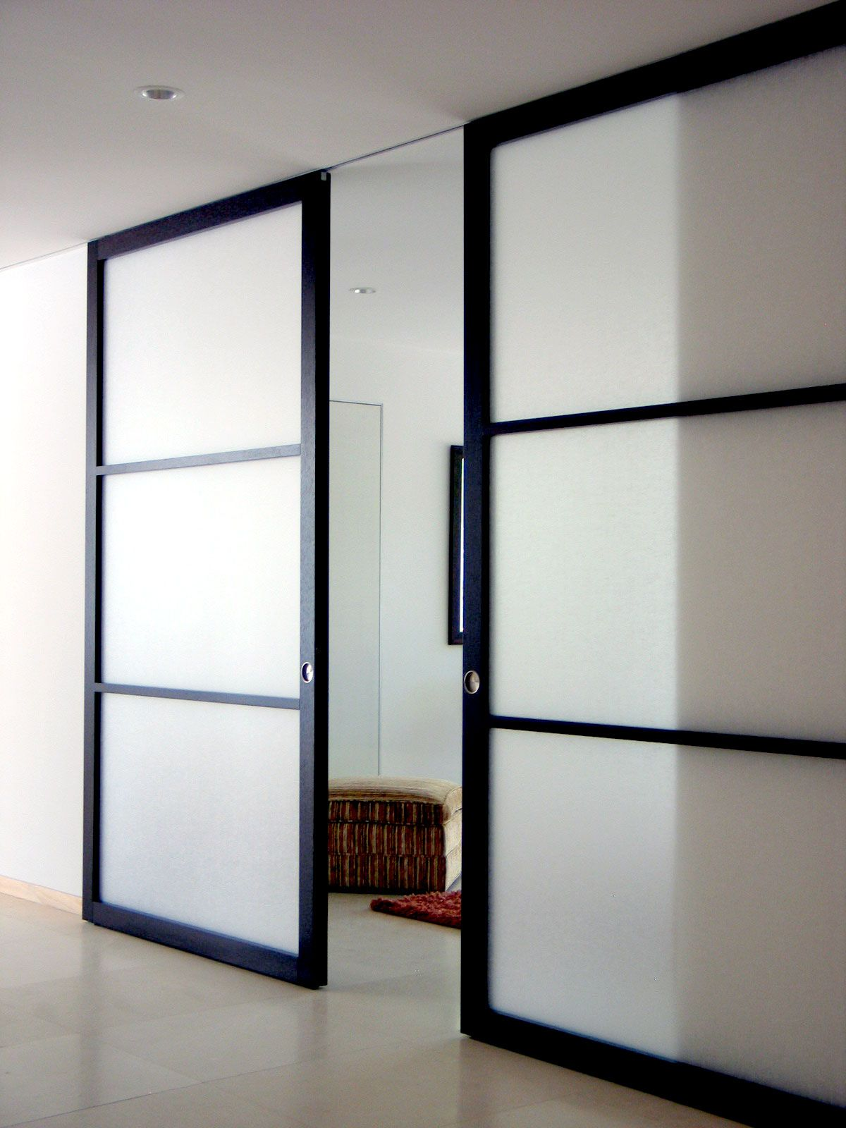 Quick And Easy Our Systems Also Utilize Trackless Design So You Ll Never Have To See The Footp Custom Sliding Doors Glass Barn Doors Sliding Barn Door Hardware