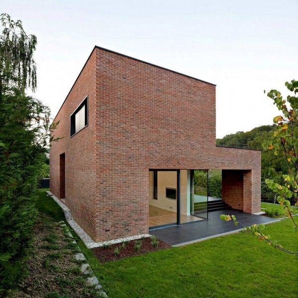 Impressive brick monolithic home with minimalist interiors for 1950s minimalist house