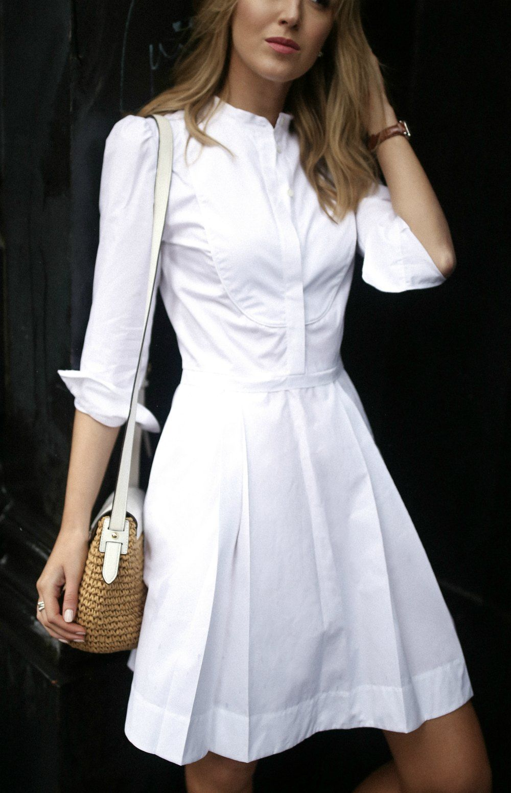 White cotton sheath knee length dress with tuxedo collar and pleats