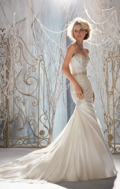 Mori Lee Bridal 1958. Sleek, with the right amount of beading to give off the right amount of sparkle for your holiday wedding.