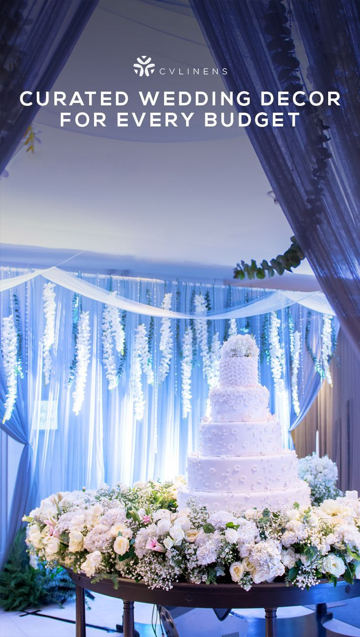Floral white wedding reception with sheer draping and blue