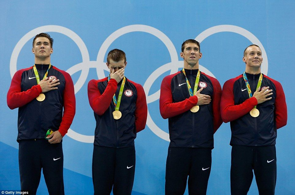 First-time Olympian Ryan Held can't contain his emotions on the podium.