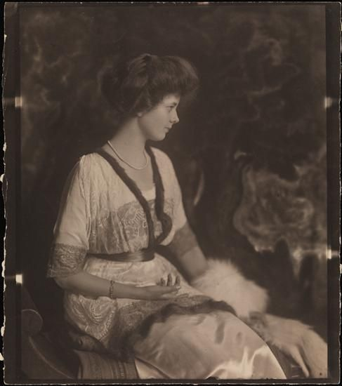 [Profile of unidentified woman with a fur trimmed dress and landscape backdrop]