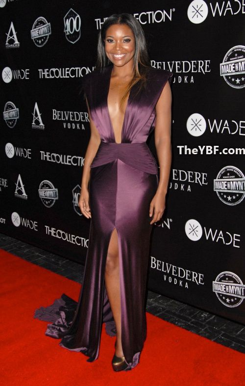 Gabrielle Union Wears Marc Bouwer Couture Burgundy Plunging V Neck Satin Gown