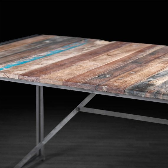 """$1,745 Urban Dining Table Made of Recycled Boat Wood and available ay ARTEMANOdotUS in Montreal.  Free shipping.  This table is available in two sizes: 60"""" L x 40"""" W x 30"""" H 80"""" L x 40"""" W x 30"""" H Made of iron and reclaimed wood salvaged from old fishing boat wrecks in Indonesia"""