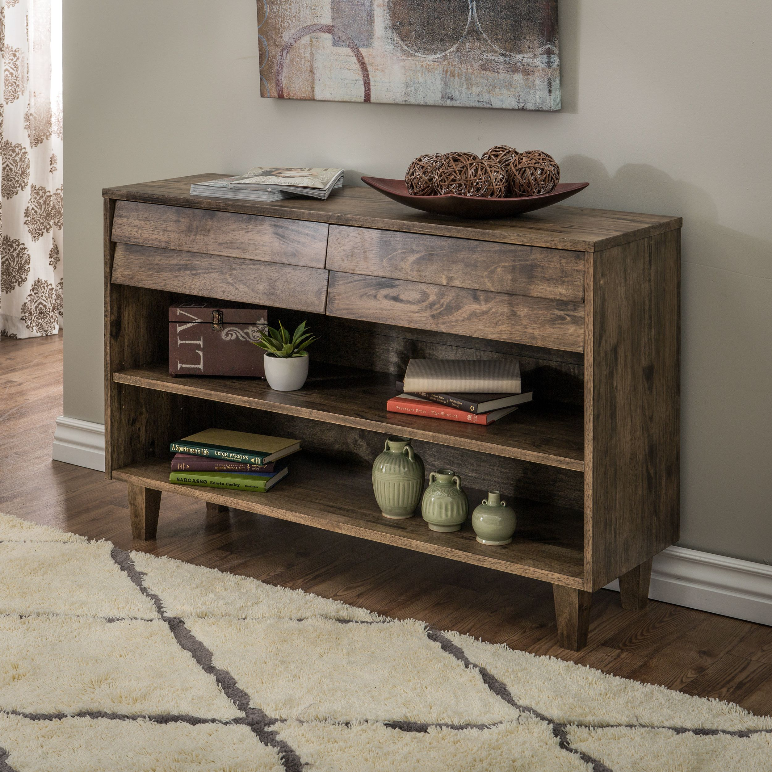 Solid rubber wood finished with a natural burn gives this venetian console table a rustic yet refined appearance with two drawers and two open shelves for