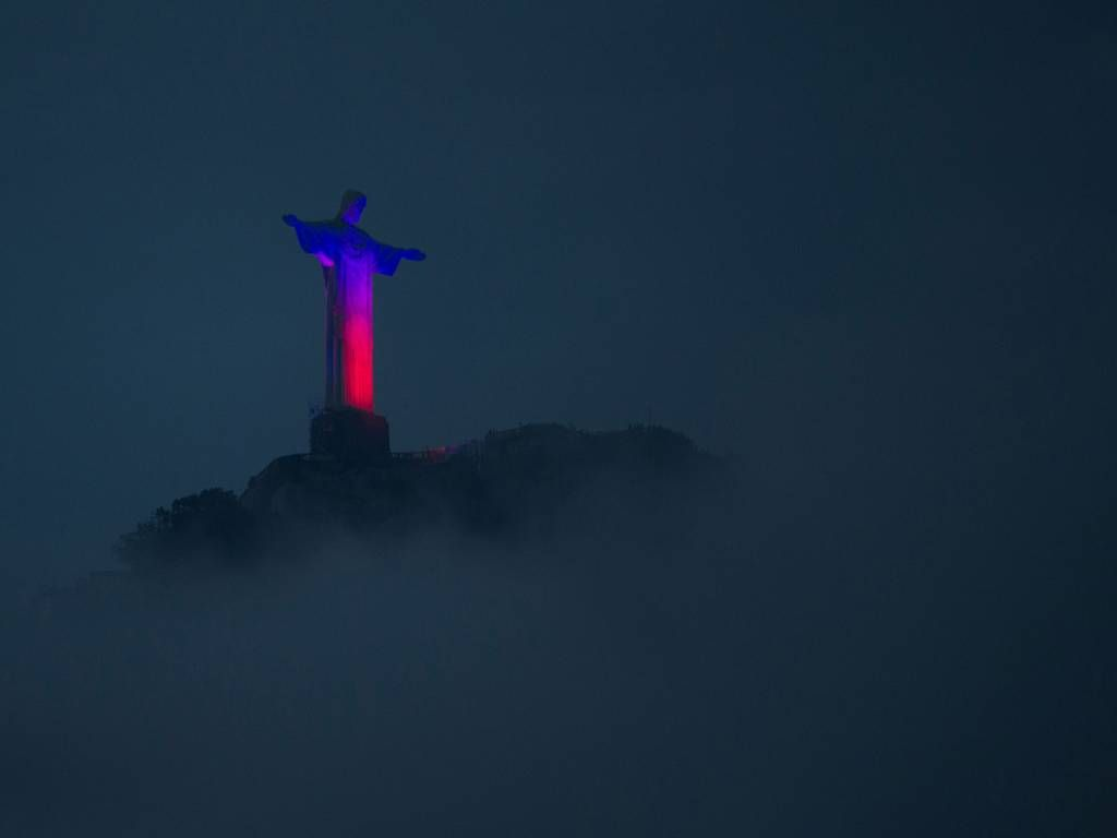 12 March 2015 The Christ The Redeemer statue, sitting atop Corcovado Mount, is lit in red and blue, in Rio de Janeiro CHRISTOPHE SIMON/AFP/Getty Images