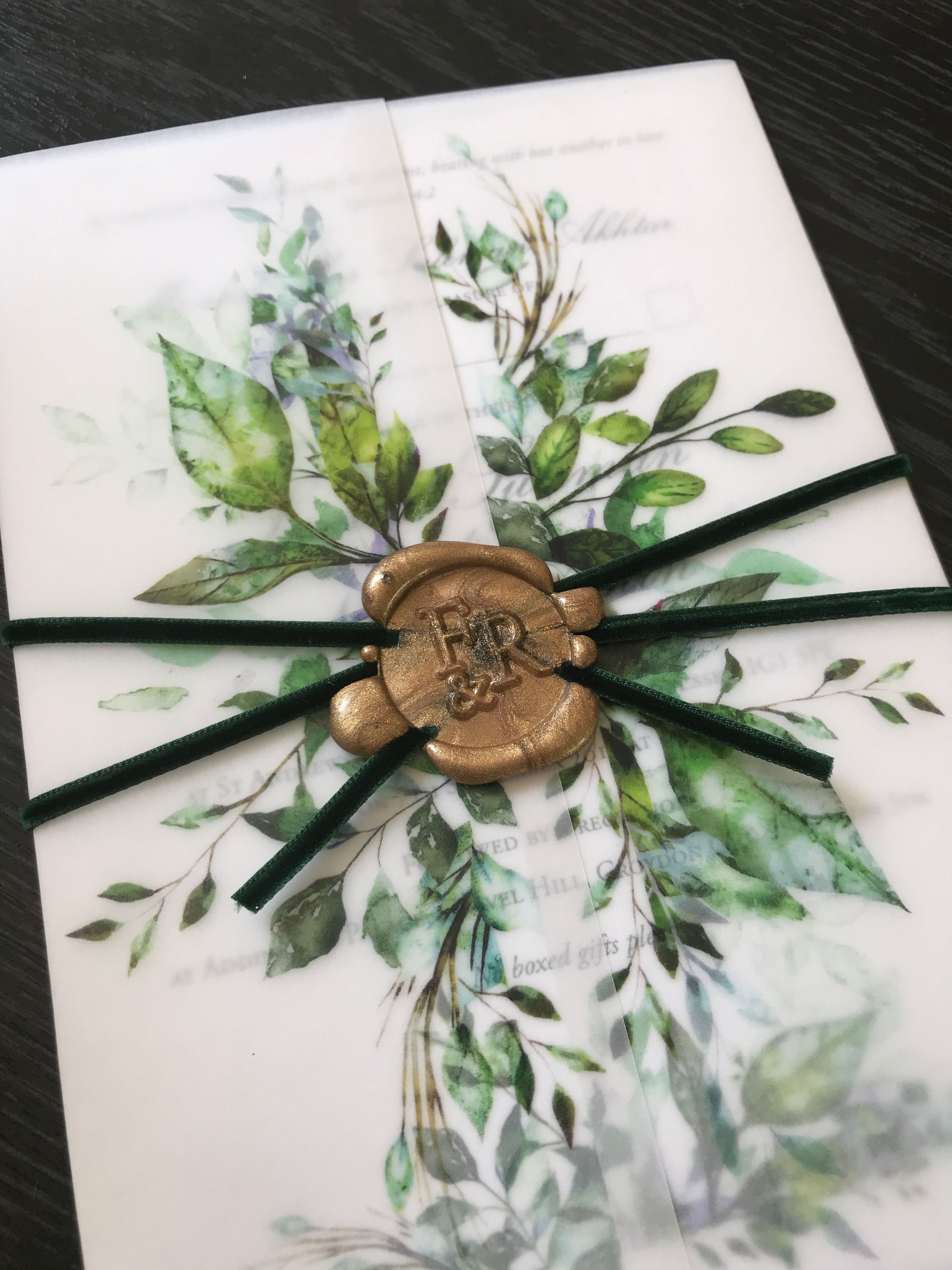 Green foliage wedding invitations with forest green ribbon and gold wax seal