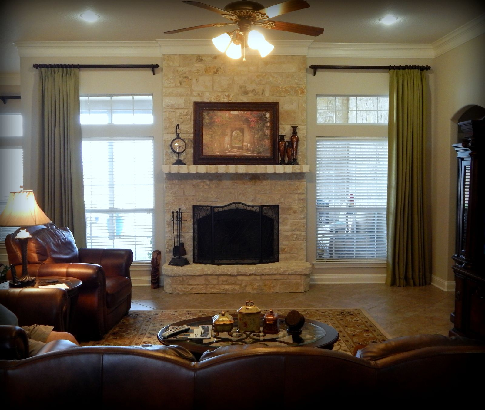 Living Room With Fireplace And Windows custom drapes frame out fireplace. no room for two panels on each