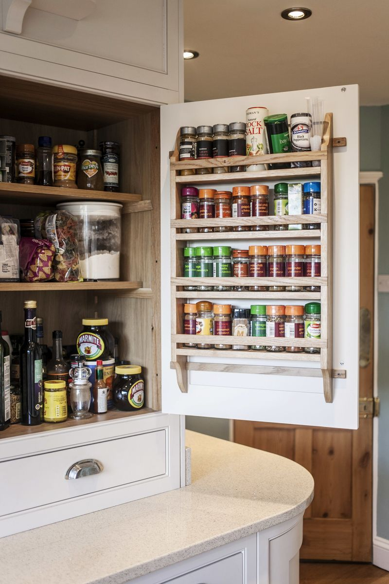 A bespoke kitchen cabinet with adjustable shelving, and ...