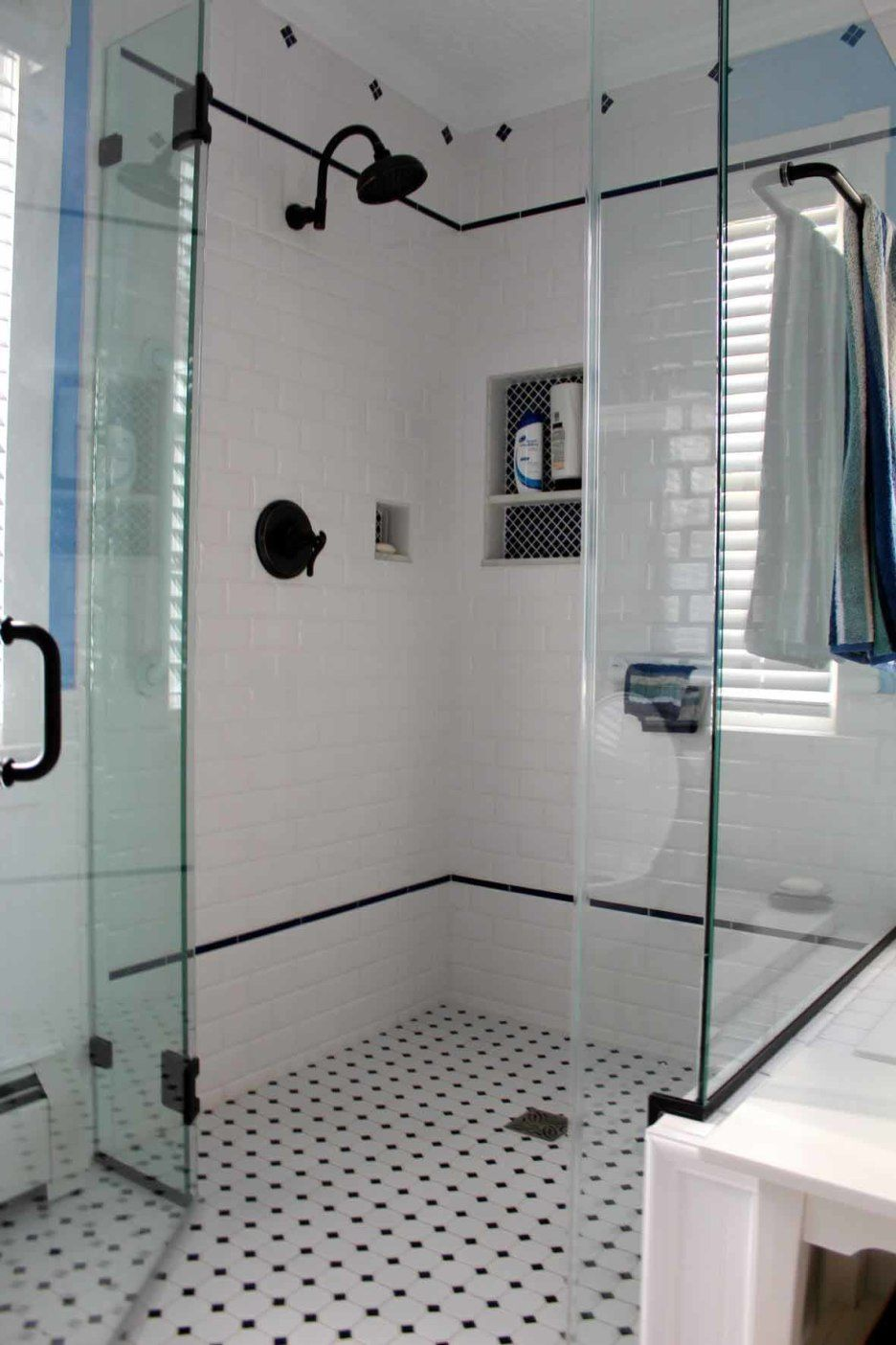 Bathroom white and black diamond mosaic tile floor for for Cool shower door ideas