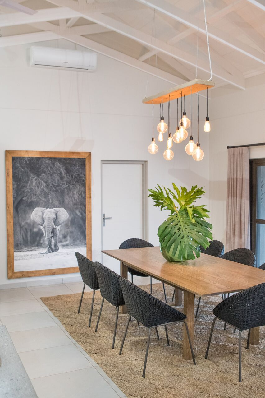 Bushwillow Villa Modern African Interiors Weylandts Dining Chairs Seagrass Mat Tropical Dining Room Dining Area Design Decor African decor dining room