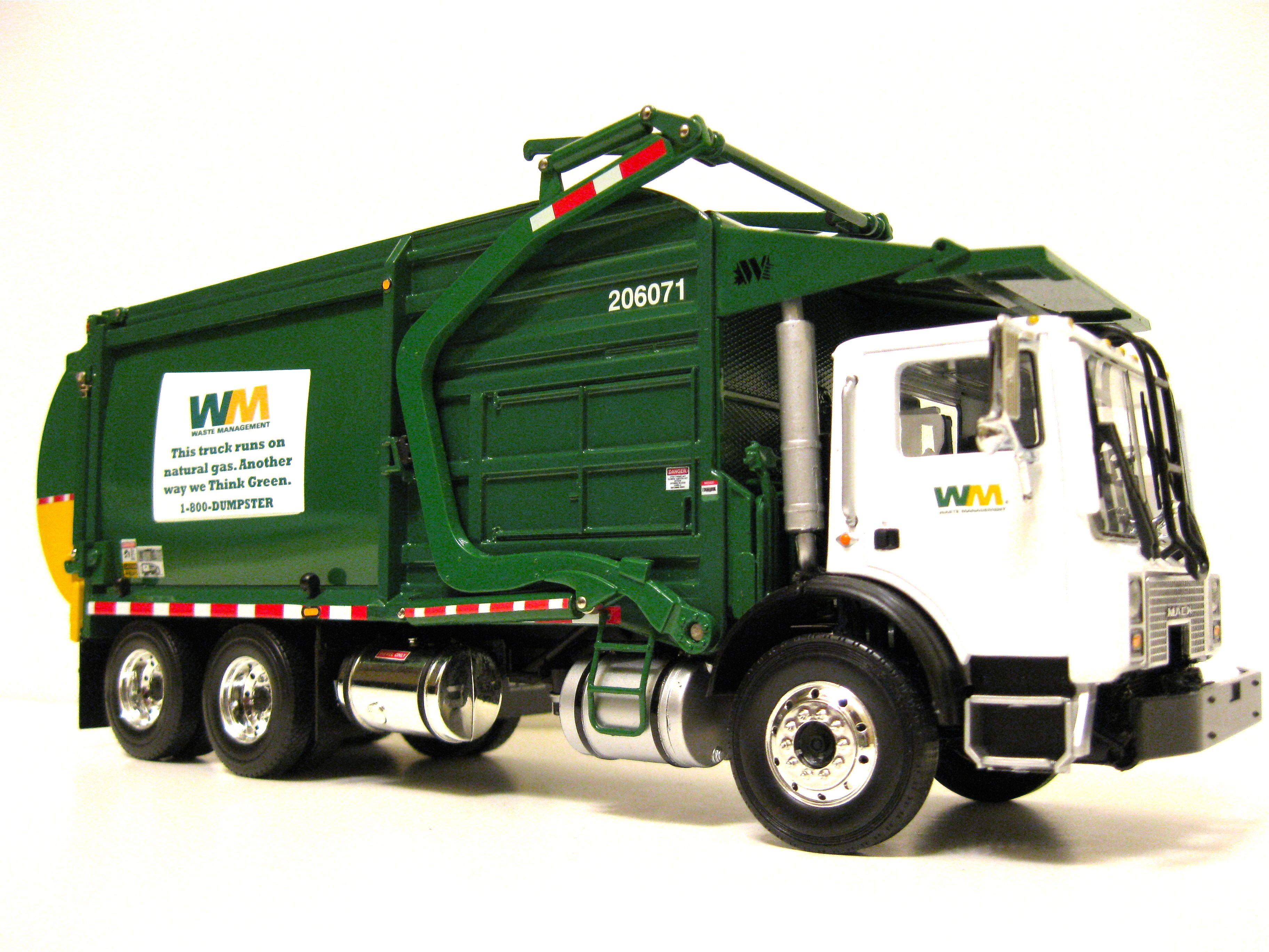 small resolution of first gear waste management front load garbage truck flickr