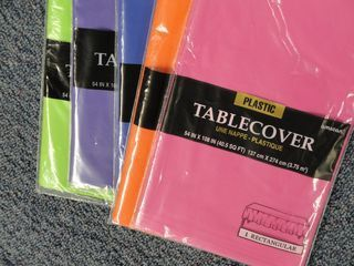 Plastic tablecovers for Bulletin Boards. They are bright year to year without fading, and it saves some trees. So smart!